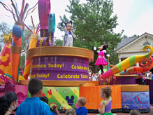 Mickey Mouse leads the Celebrate Dreams Come True Parade down Main Street USA