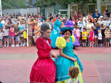 Cinderella's Stepsisters talk to children along the parade route