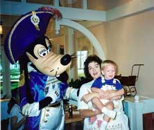 Andrew age 15 months with Mom and Goofy