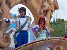 Little Mermaid and Prince Eric wave to parade onlookers